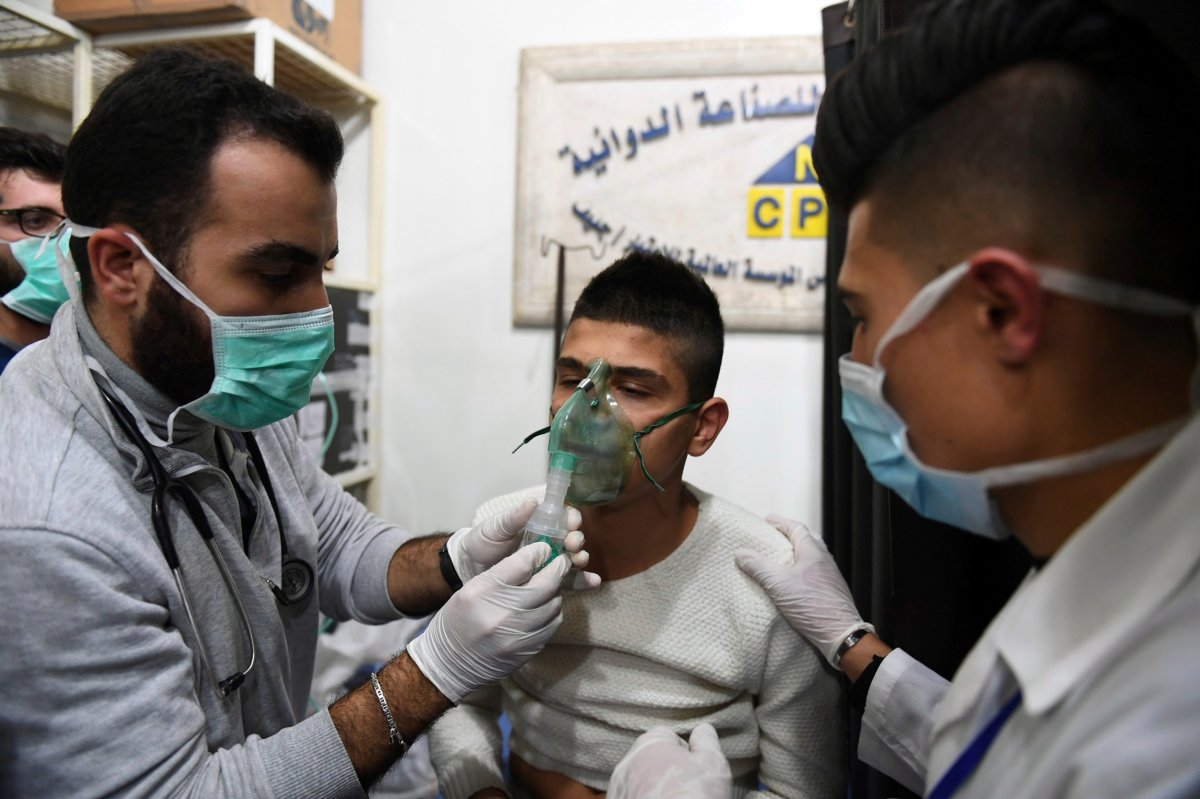 In this photo released by the Syrian official news agency SANA, shows a man receiving oxygen through respirators following a suspected chemical attack on his town of al-Khalidiya, in Aleppo, Syria, Saturday, Nov. 24, 2018.