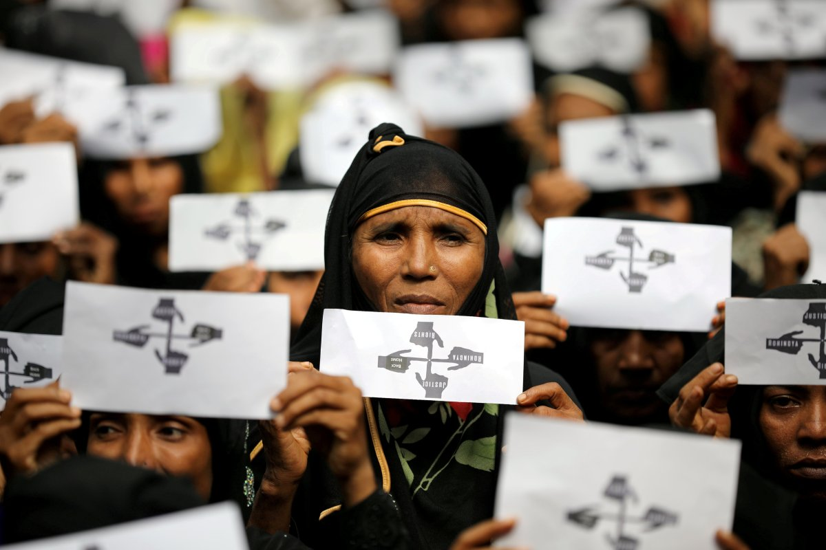 Rohingya refugee women hold placards as they take part in a protest at the Kutupalong refugee camp to mark the one-year anniversary of their exodus in Cox's Bazar, Bangladesh, August 25, 2018.