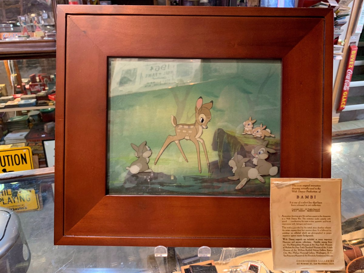 """A framed animation drawing from the movie """"Bambi"""" is seen in this undated handout photo. The owner of an Edmonton antique shop is helping out a homeless man who found a valuable Bambi animation drawing in a dumpster. Alexander Archbold of Curiosity Inc. says the man he knew only as Adam had been turned away by a few stores before he showed up in his shop with the artwork in September."""