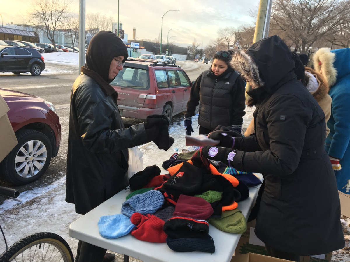 Bundled-up students handed out winter gear to those in need at the corner of Main Street and Dufferin Avenue on Sunday afternoon.
