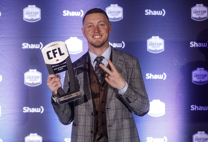 Winner of Most Outstanding Player, Calgary Stampeders quarterback Bo Levi Mitchell, holds his award during the Shaw CFL Awards in Edmonton on Thursday, Nov. 22, 2018.