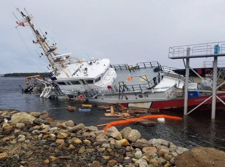 The vessel slipped from its cradle, crashing into the ocean floor and coming to rest partially submerged in the icy water of Sambro Harbour.
