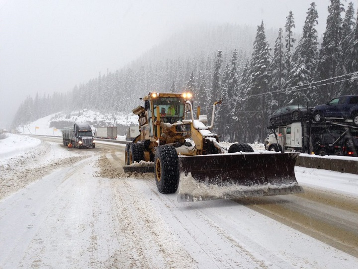 A grader plowing snow on the Coquihalla highway in central B.C. on November 14, 2018.