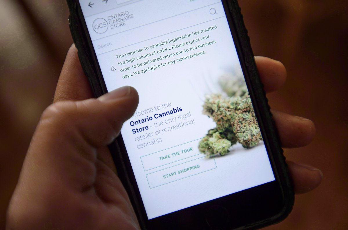 The Ontario Cannabis Store website is pictured on a mobile phone Ottawa on Thursday, Oct. 18, 2018. The Canadian Press placed 13 online orders on the afternoon of Oct. 17 of the cheapest available gram of dried flower in each province and territory available across the country - and three have still yet to arrive more than one week later.
