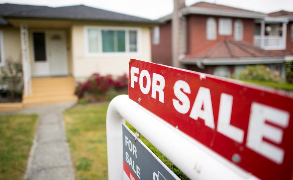 A real estate sign is pictured in Vancouver on June, 12, 2018.
