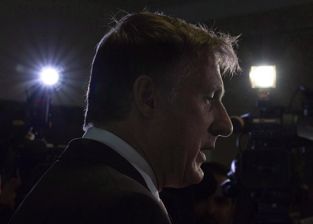 Maxime Bernier speaks with the media after filing papers for the Peoples Party of Canada at the Elections Canada office in Gatineau, Que., Wednesday, October 10, 2018.