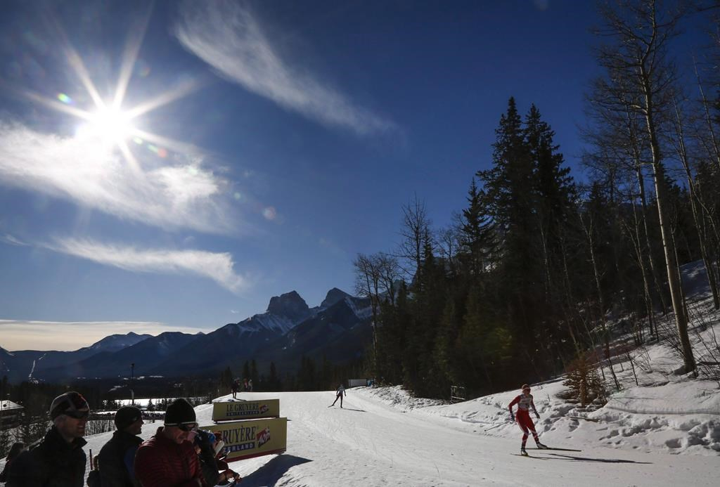 Skiers compete during World Cup cross country skiing women's 10km event in Canmore, Alta., Friday, March 11, 2016. The mayor of Canmore says he's disappointed that Calgary's bid for the 2026 Olympic and Paralympic Winter Games was rejected by Calgarians. THE CANADIAN PRESS/Jeff McIntosh.