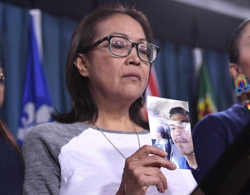 "Debbie Baptiste, mother of Colten Boushie, holds a photo of her son during a press conference on Parliament Hill in Ottawa on February 14, 2018. The Saskatchewan throne speech last month included a reference to changing trespassing laws to ""better address the appropriate balance between the rights of rural landowners and members of the public."" The province has already sought public input on whether access to rural property should require prior permission from a landowner, regardless of the activity, and if not doing so should be illegal. A lawyer representing the family of Colten Boushie, an Indigenous man fatally shot by farmer Gerald Stanley in August 2016, said she is worried the Saskatchewan Party government is engaged in political posturing which could stoke racial fear. THE CANADIAN PRESS/Justin Tang."