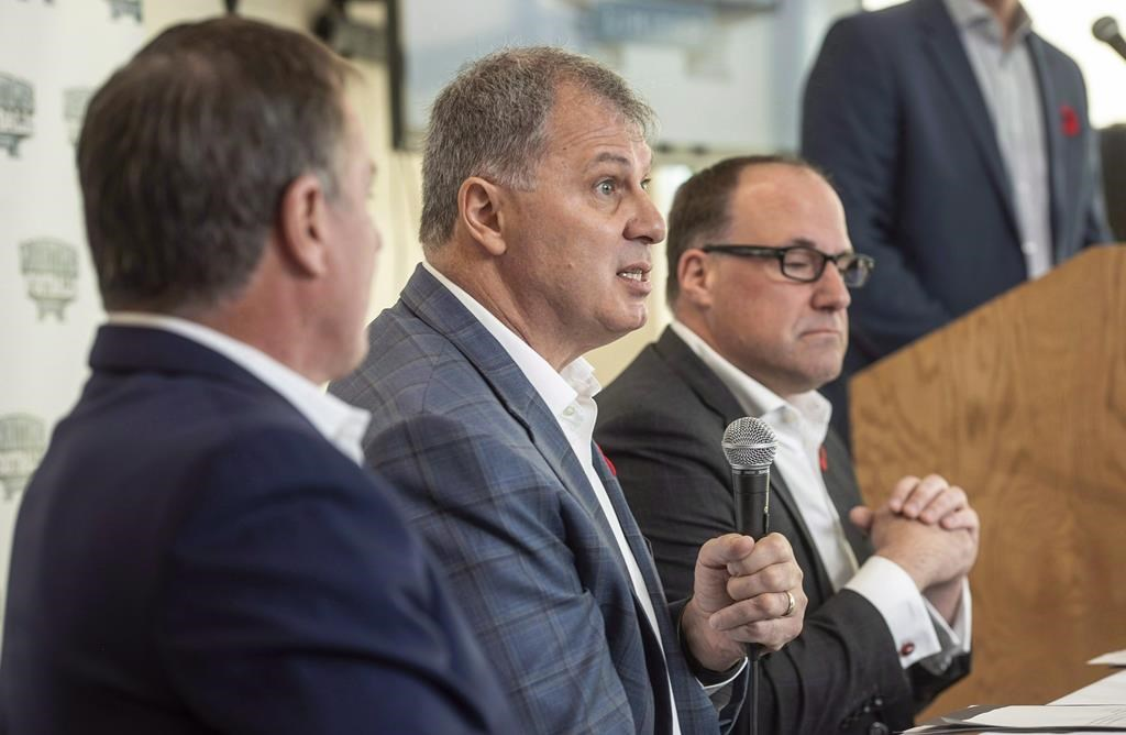 CFL commissioner Randy Ambrosie, centre, speaks to reporters during a press conference with Maritime Football Limited Partnership founding partners Bruce Bowser, left, and Anthony LeBlanc in Halifax on Wednesday, Nov. 7, 2018.