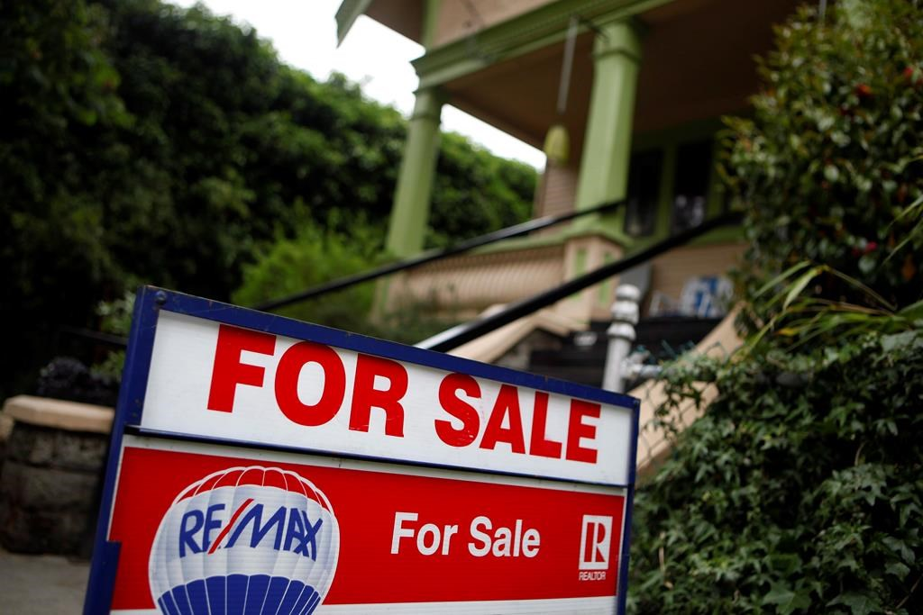 A real estate sign is shown in Victoria, B.C., on Friday, June 1, 2018. They say breaking up is hard to do - and that most often can be the case when it comes to leaving your realtor. Although not overly common, there may come a time when you want to ditch the real estate agent you have entrusted to sell or buy you a home.