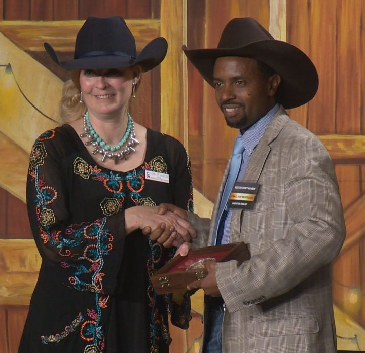Colleen Goertz presented Jean-Claude Munyezamu with the innovation award for his work with Soccer Without Boundaries.
