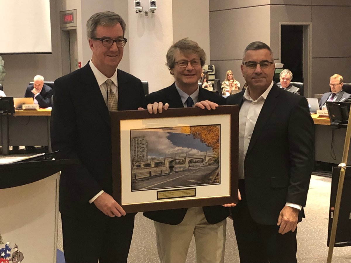 David Chernushenko (centre) was the city councillor for Capital Ward for eight years. Ottawa Mayor Jim Watson (left) and city manager Steve Kanellakos (right) recognized Chernushenko, who was not re-elected in October, for his public service during the final city council meeting of the term on Nov. 28, 2018.