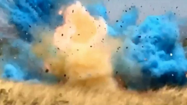 An explosive package filled with coloured powder detonates in this still image captured from video in April 2017, near Tucson, Arizona.