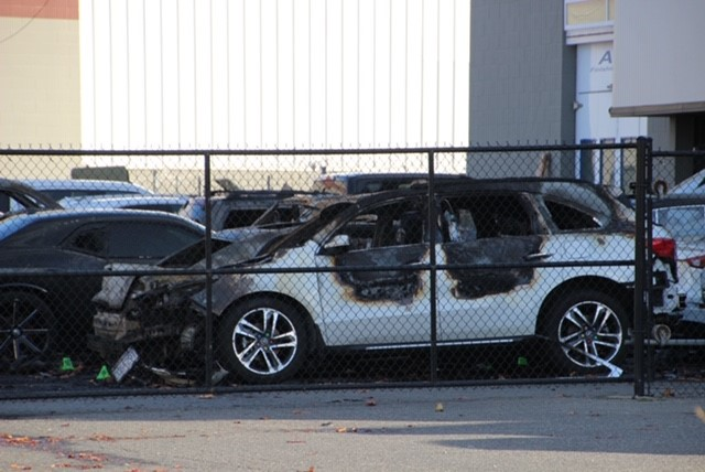 One of several burned-out cars that investigators believe may have been deliberately set on fire.
