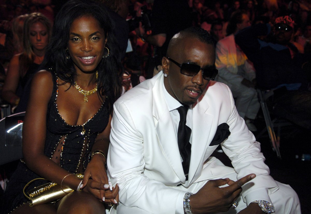 Kim Porter and Sean P. Diddy Combs during 2004 MTV Video Music Awards - Backstage and Audience at American Airlines Arena in Miami, Florida, United States.