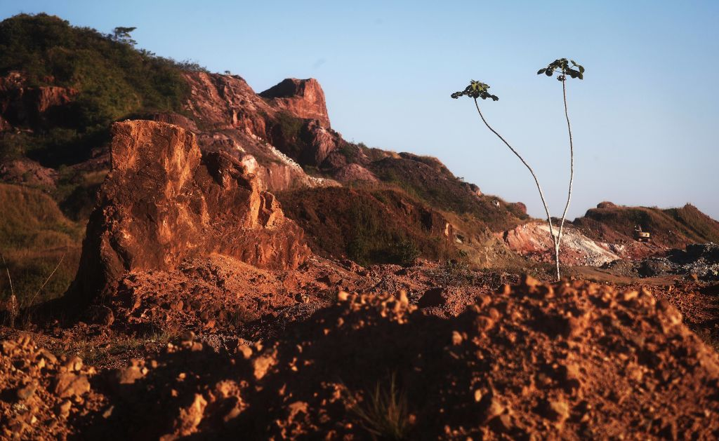 Amazon soil sits in the foreground at the Bom Futuro open air tin mine, one of the largest tin mines in the world, in a deforested section of the Amazon rainforest on June 27, 2017 in Bom Futuro, Brazil.