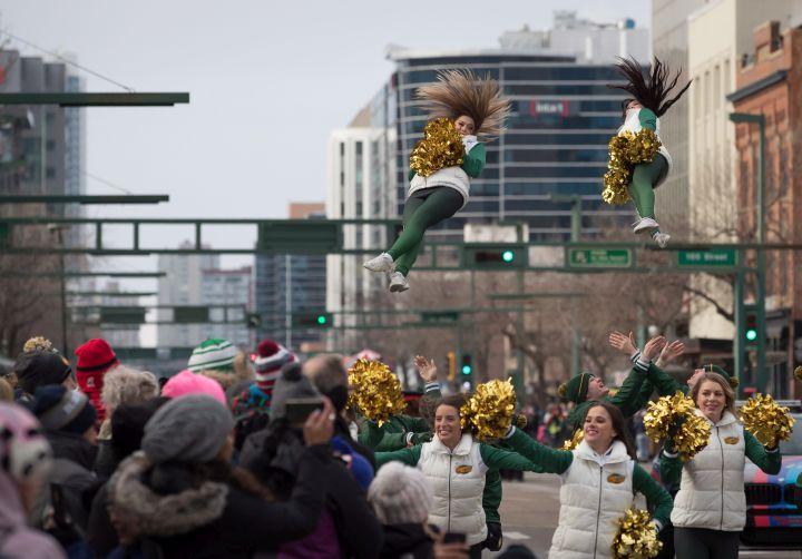 Members of the Edmonton Eskimos cheer team are thrown in the air during the Grey Cup parade in Edmonton, Alta., on Saturday November 24, 2018.