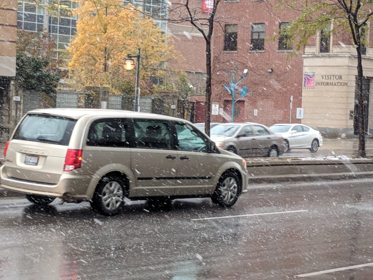 Londoners were greeted with flurries on their Friday morning commute.