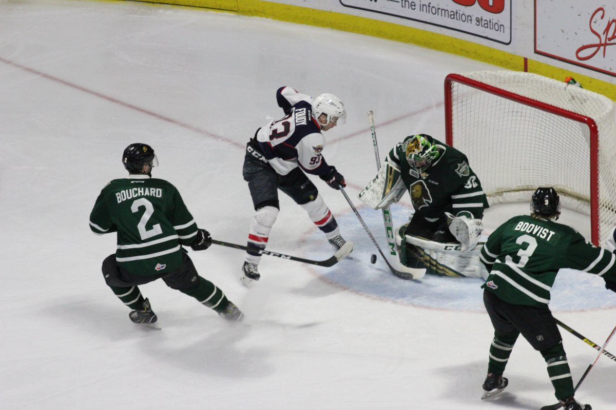 Windsor, Ont. - London Knights goaltender Joseph Raaymakers stops Jean-Luc Foudy of the Windsor Spitfires right in front of the London net to help London improve to 14-0-1 in their last 15 games.