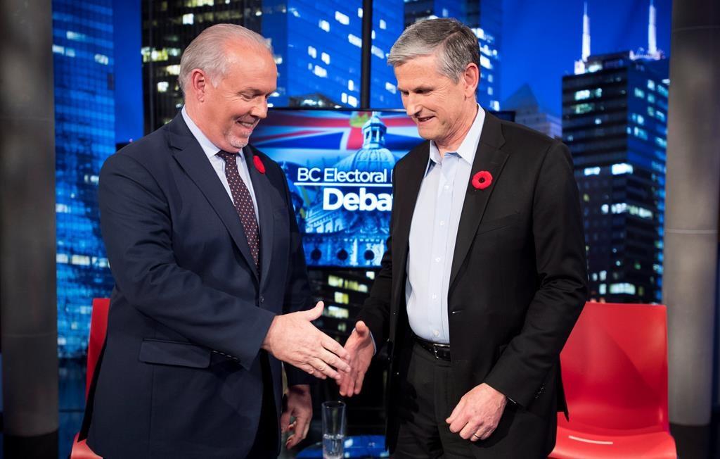 Premier John Horgan and Liberal leader Andrew Wilkinson following the Electoral Reform Debate at Global Television in Burnaby, B.C. Thursday, Nov., 8, 2018. THE CANADIAN PRESS/Jonathan Hayward.