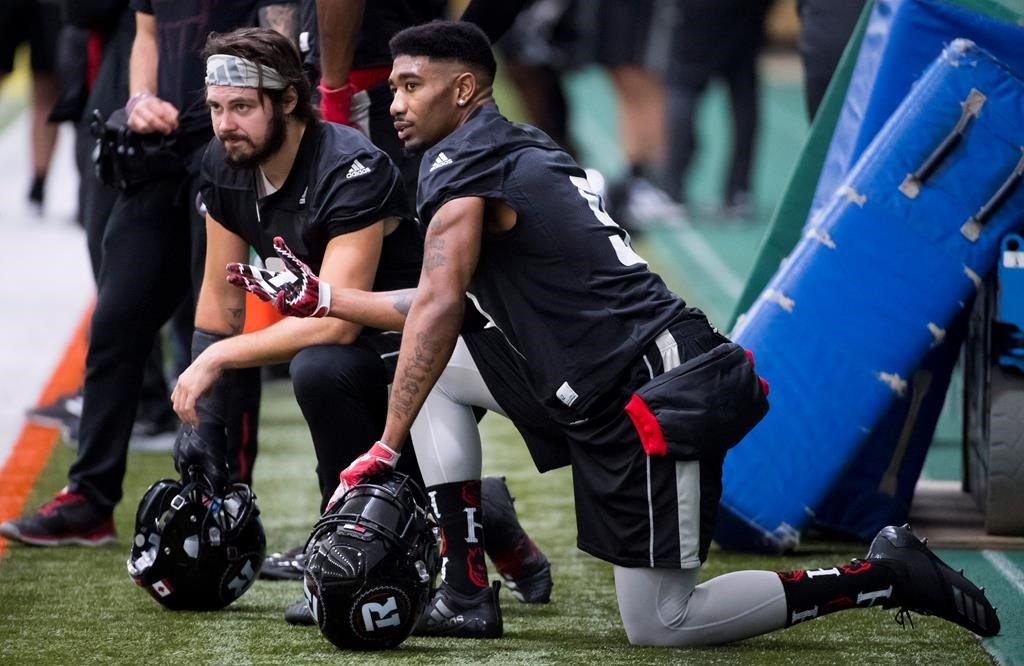 Ottawa Redblacks defensive back Jonathan Rose (9) speaks with teammate defensive back Antoine Pruneau (6) during a team practice in Edmonton, Wednesday, Nov. 21, 2018. The 106th Grey Cup will be played Sunday between the Ottawa Redblacks and the Calgary Stampeders. THE CANADIAN PRESS/Jonathan Hayward.