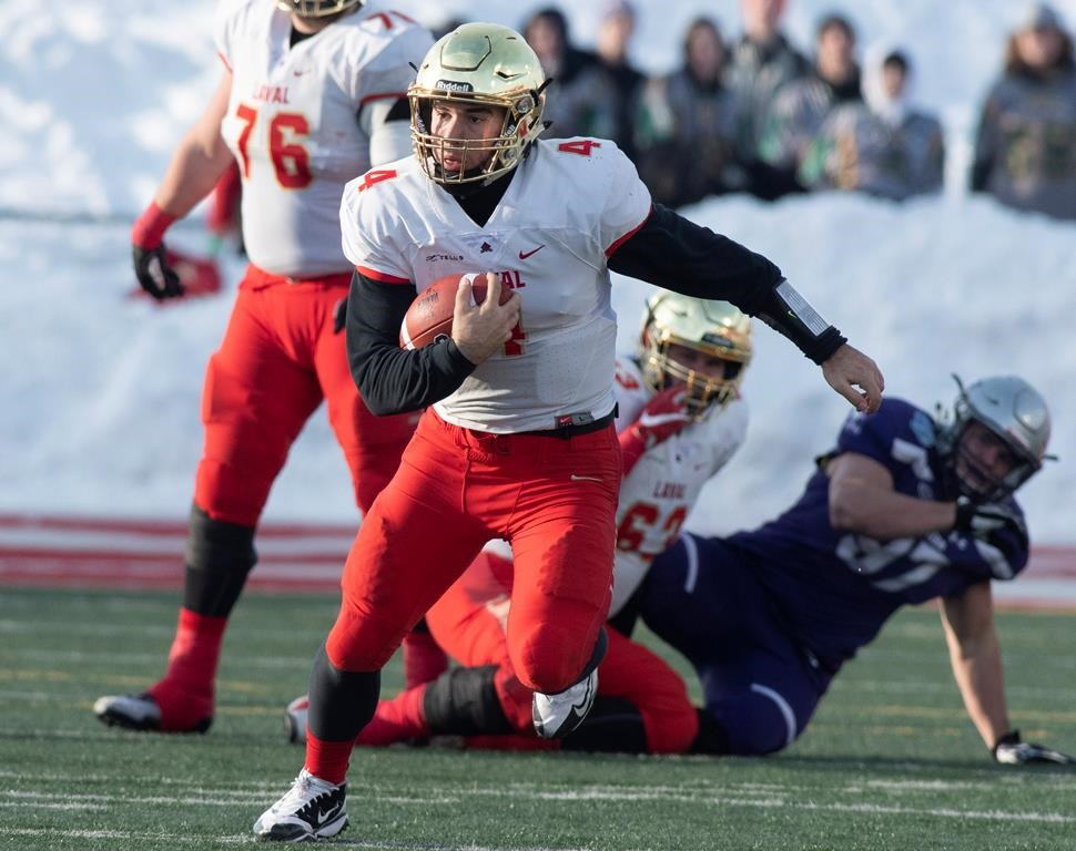 Laval University Rouge et Or's quarterback Hugo Richard runs to a first down against Western University Mustangs during second quarter action of the Vanier Cup final Saturday, November 24, 2018 in Quebec City.