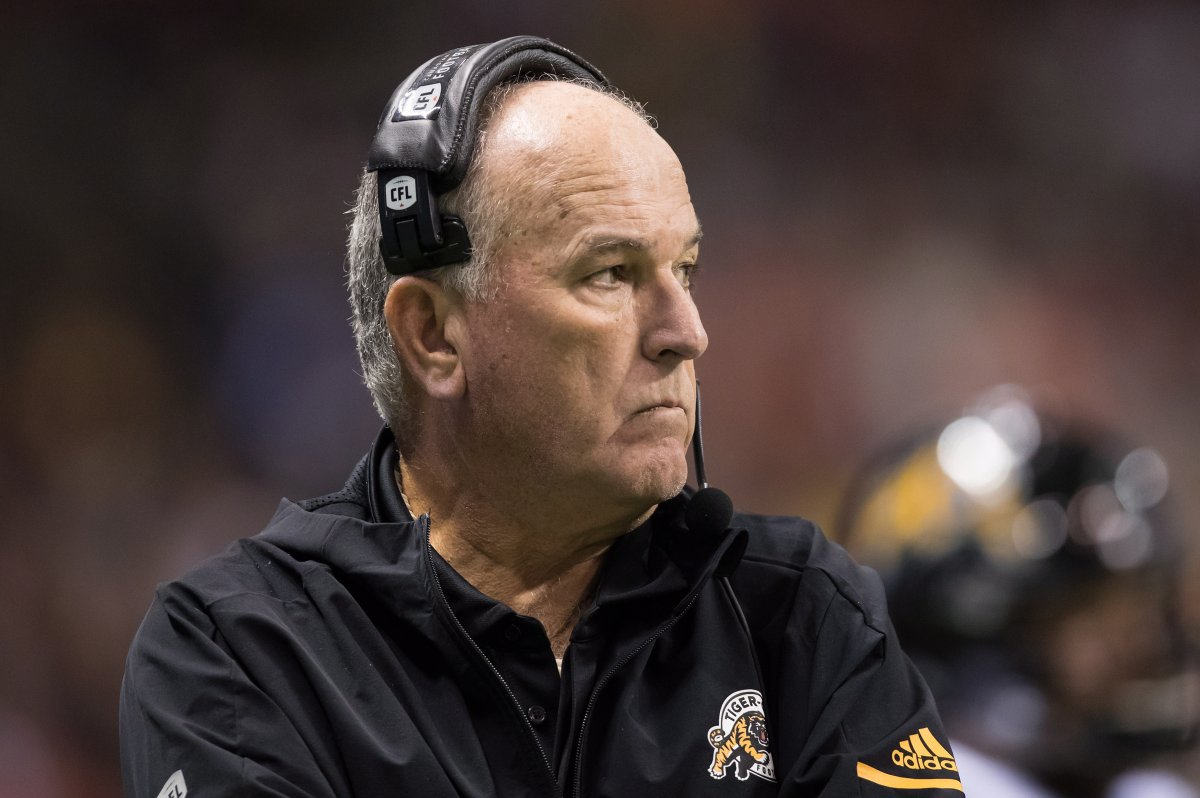 Hamilton Tiger-Cats head coach June Jones stands on the sideline during the first half of a CFL football game against the B.C. Lions in Vancouver on Saturday, Sept. 22.