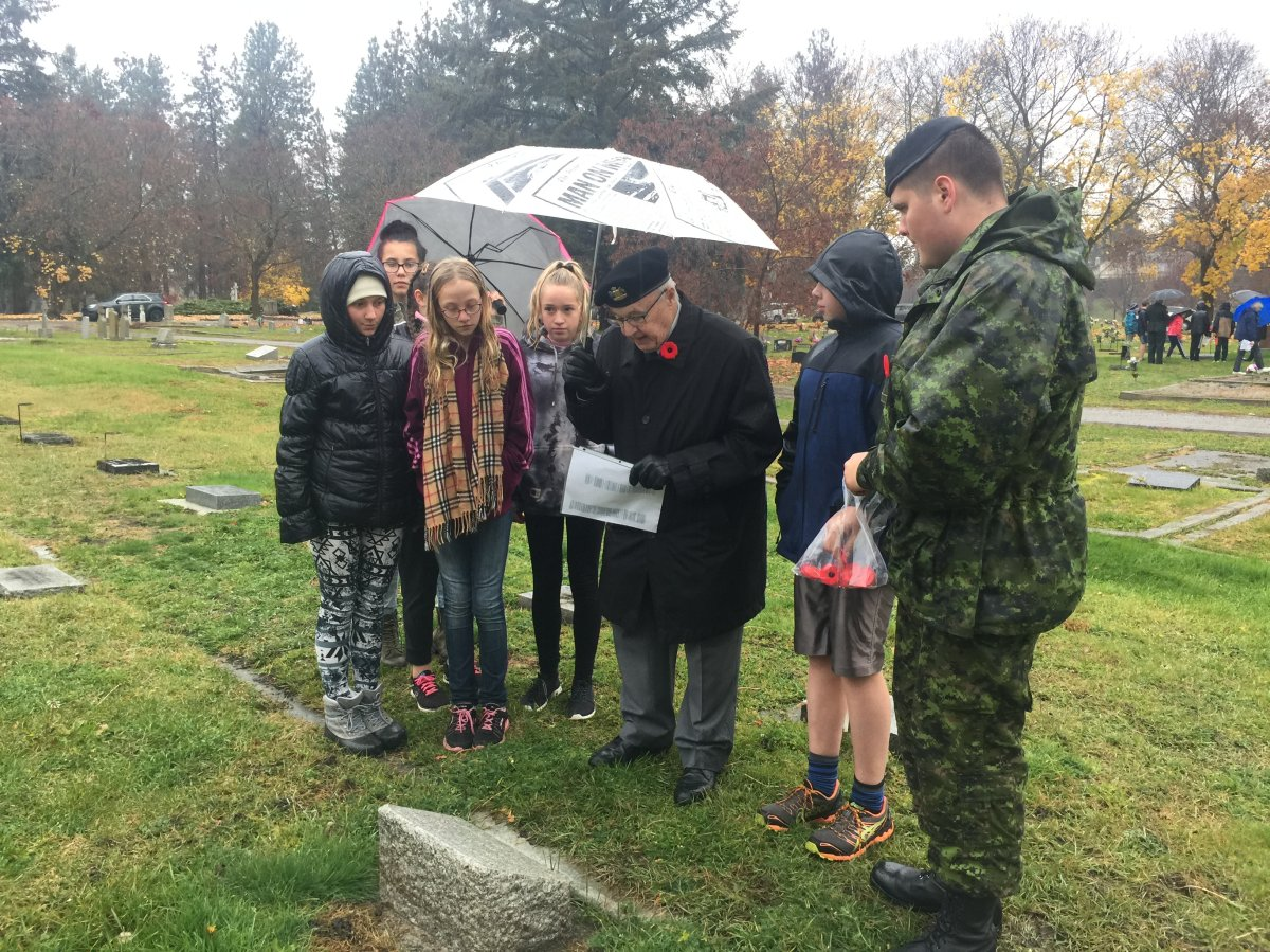 Poppies are laid on veteran  headstones at Pleasant Valley Cemetery in Vernon Thursday morning.