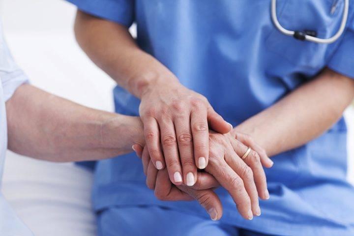 File: Nurse with a patient.