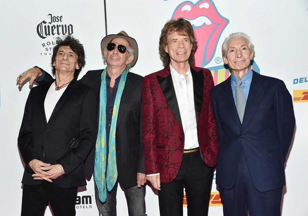 """FILE - In this Nov. 15, 2016 file photo, The Rolling Stones, from left, Ronnie Wood, Keith Richards, Mick Jagger and Charlie Watts attend the opening night party for """"Exhibitionism"""" in New York. The Rolling Stones will be rolling through the U.S. next year. The band says it is adding a 13-show leg to its No Filter tour in spring 2019, kicking off in Miami on April 20."""