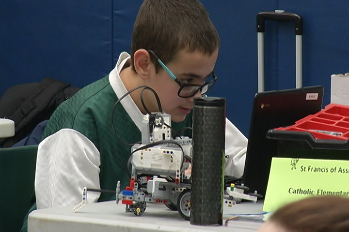 A student works on his robot during a robotics competition at St. Patrick Elementary School in Ontario.