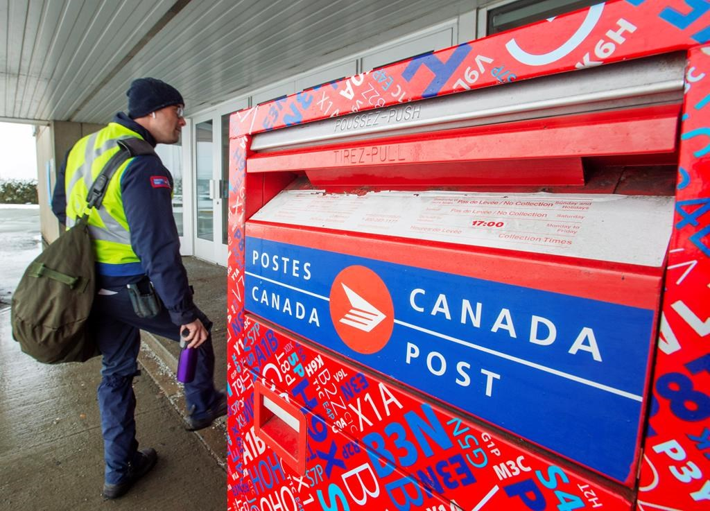 Canada Post workers return to work after the government ordered them to end their rotating strike on Tuesday, Nov. 27, 2018 in Montreal.