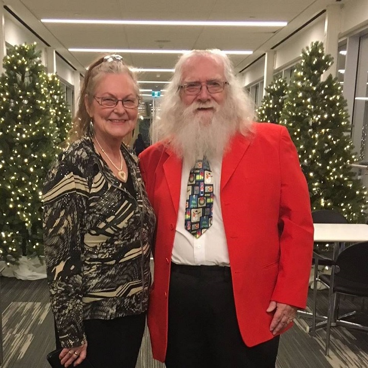Brian Sanderson (right) poses with Lillian Harrison. The pair worked together as Mr. and Mrs. Claus helpers at their local mall for eight years.
