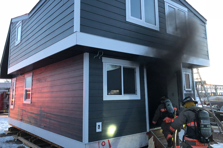 A Saskatoon fire investigator determined the cause to be building materials placed too close to a construction heater.