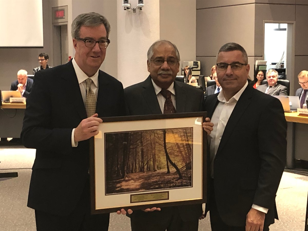 Shad Qadri (centre) was the city councillor for Stittsville for last 12 years. Ottawa Mayor Jim Watson (left) and city manager Steve Kanellakos (right) recognized Qadri, who was defeated in October's municipal election, for his public service during the final city council meeting of the term on Nov. 28, 2018.
