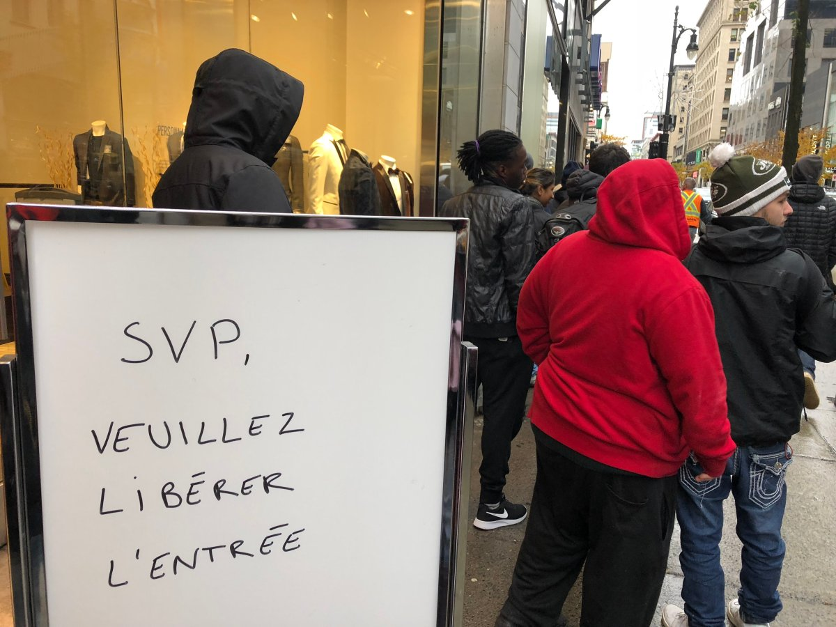 Stores near the SQDC in downtown Montreal have their entrances blocked by long lineups to access the government;s marijuana-run stores. Friday November 2, 2018.