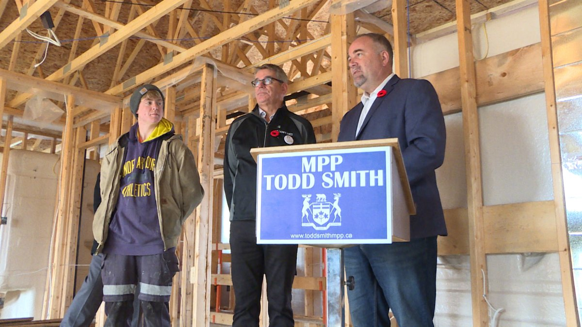 Minister of Economic Development, Job Creation and Trade Todd Smith speaks at a news conference.
