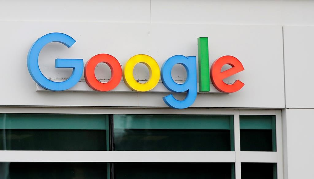 A sign on a building at the Google campus in Kirkland, Wash. is shown Thursday, Nov. 1, 2018. Google employees in Kirkland and around the world briefly walked off the job Thursday in a protest against what they said is the tech company's mishandling of sexual misconduct allegations against executives. (AP Photo/Ted S. Warren).