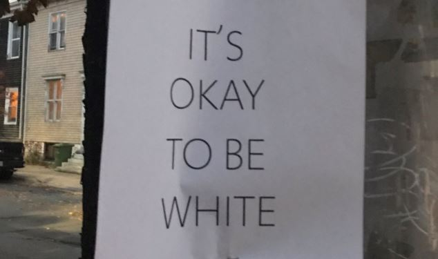 "Signs that read ""It's okay to be white"" where posted around Halifax on Halloween."