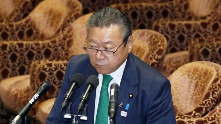 In Nov. 14, 2018, photo, ruling Liberal Democratic Party of Japan lawmaker Yoshitaka Sakurada, also in charge of the 2020 Tokyo Olympics, replies to question from independent and opposition legislators at a parliamentary session in Tokyo.