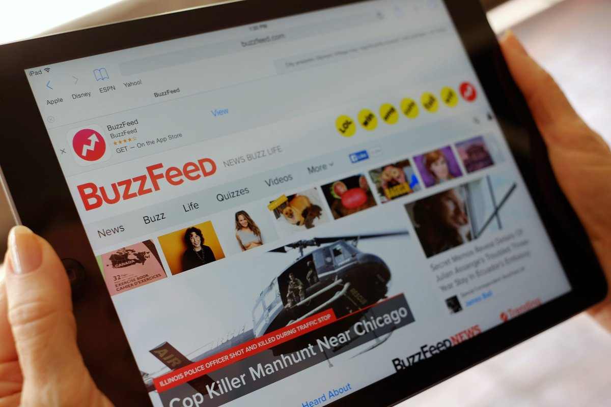The BuzzFeed website is displayed on an iPad held by an Associated Press staffer in Los Angeles, on Tuesday, Sept. 1, 2015.