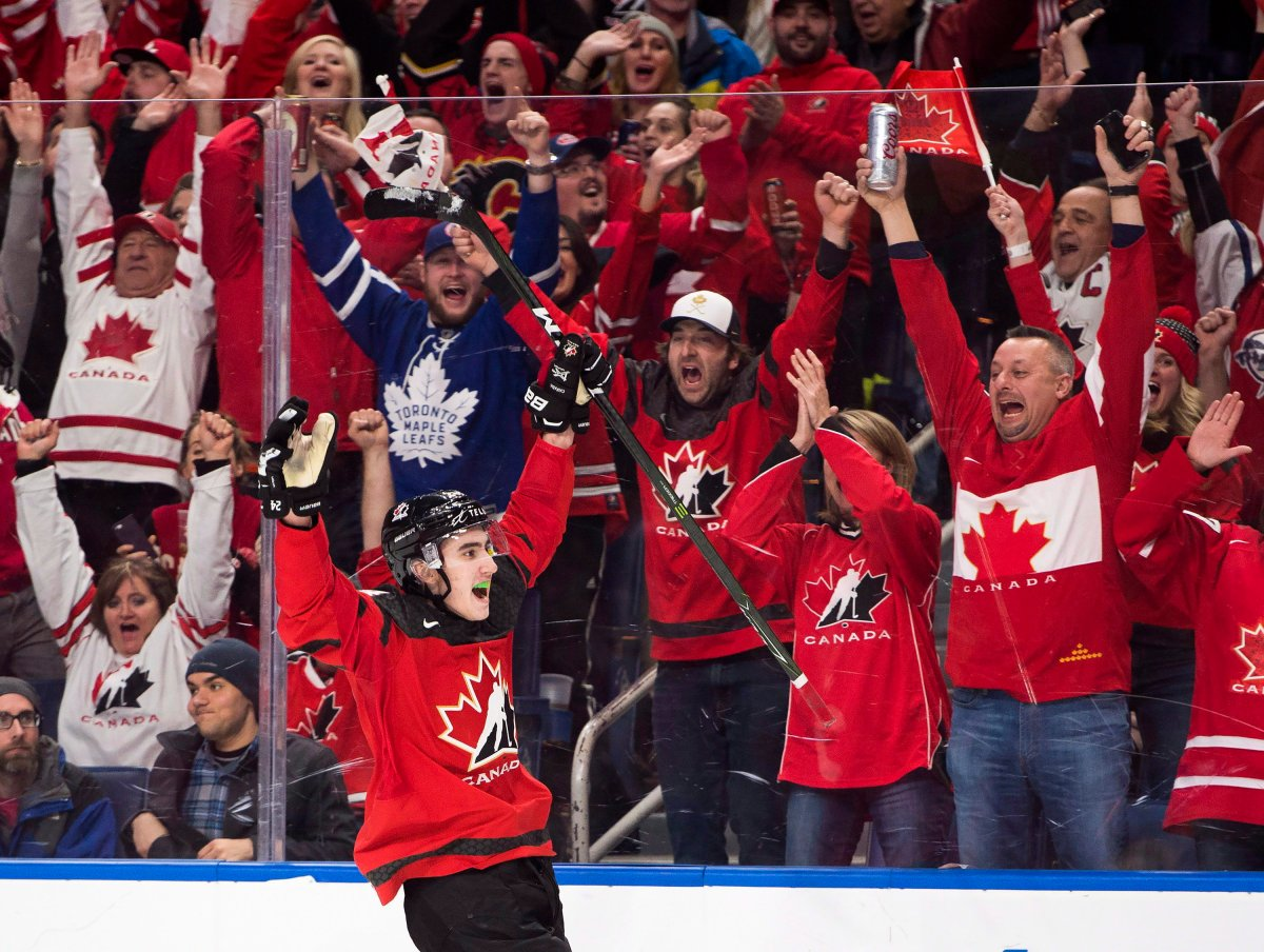 Canada forward Alex Formenton (24) celebrates his empty net goal against Sweden during third period gold medal final IIHF World Junior Championships hockey action in Buffalo, N.Y., on Friday, January 5, 2018. THE CANADIAN PRESS/Nathan Denette.