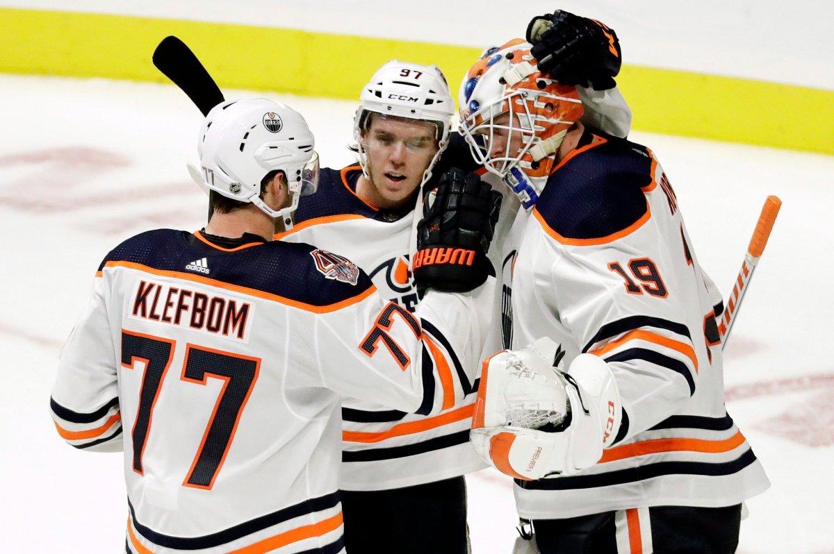 Edmonton Oilers goaltender Mikko Koskinen (19), of Finland, celebrates with defenseman Oscar Klefbom (77), of Sweden, and center Connor McDavid (97) after beating the Nashville Predators 5-3 in an NHL hockey game Saturday, Oct. 27, 2018, in Nashville, Tenn.