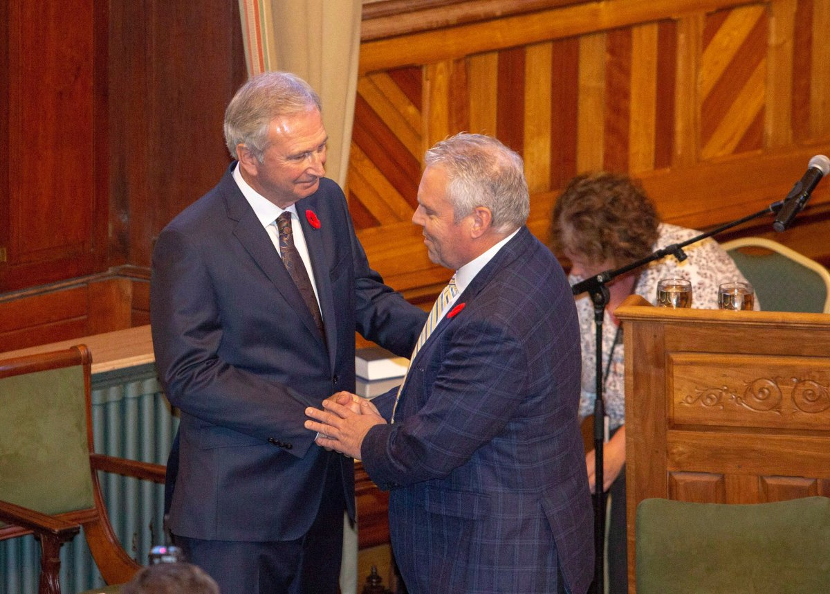 New Brunswick Progressive Conservative MLA Ernie Steeves, right, is sworn in as Minister of Finance, and President of the Treasury Board at the New Brunswick Legislature in Fredericton on Friday, Nov. 9, 2018.