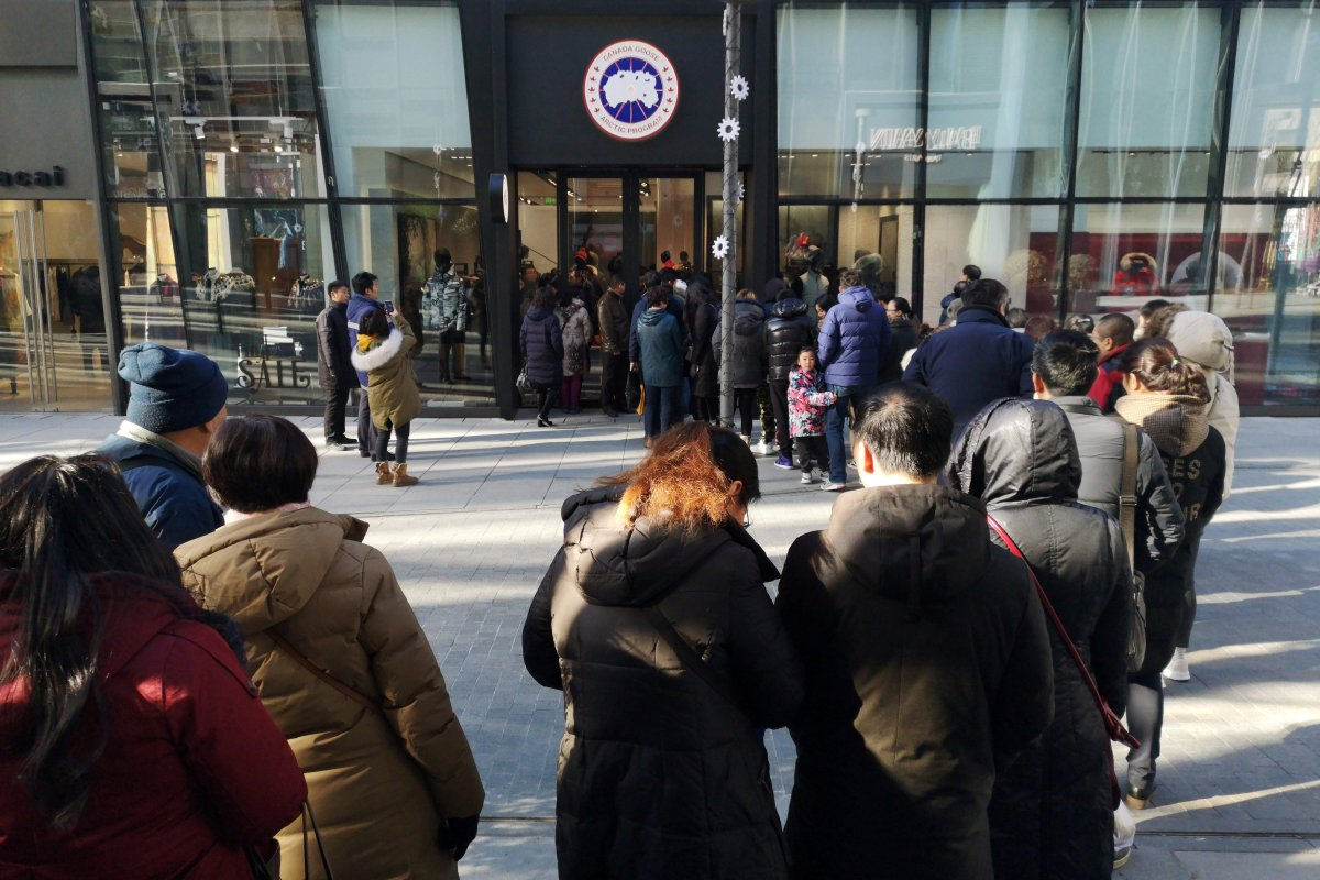 People queue outside the newly opened flagship store of Canadian luxury parka maker Canada Goose, in Sanlitun district of Beijing, China December 30, 2018.