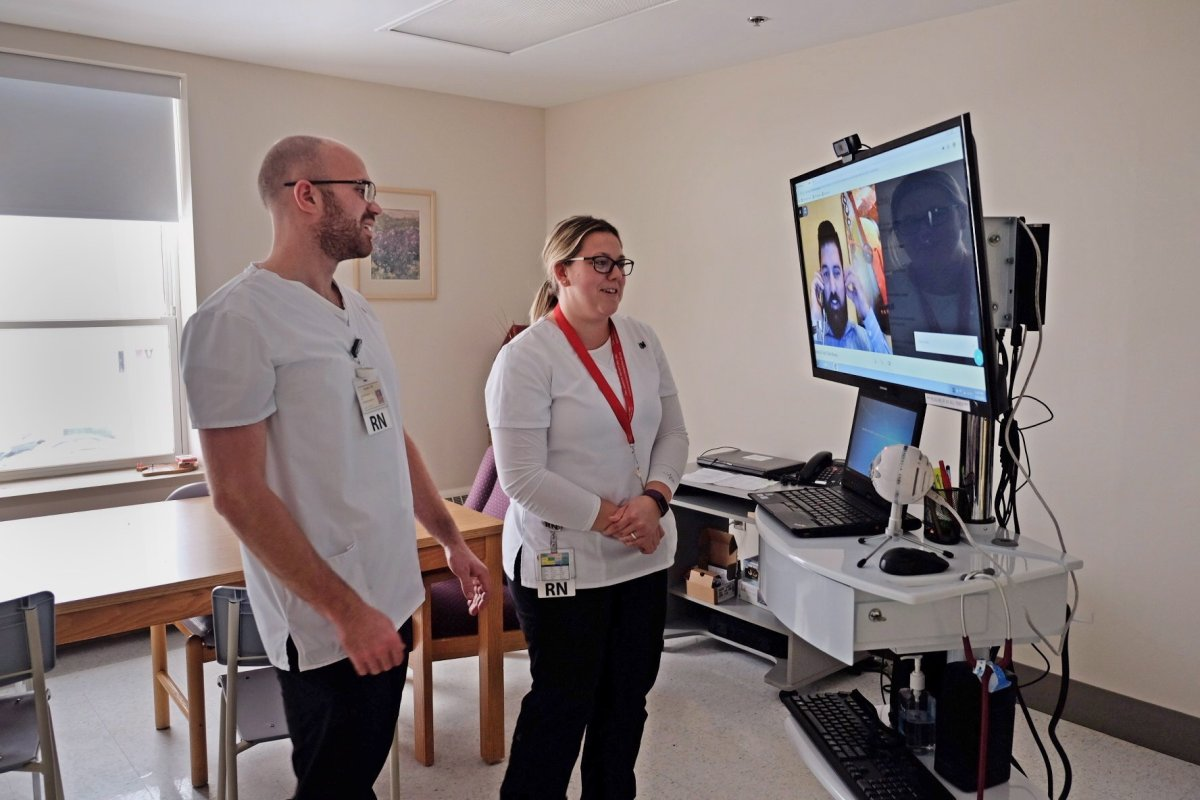 "Nurses use a TV cart with a doctor on a secure video conference link during a pilot project of ""tele-rounding"" in Alberton, P.E.I., in this undated handout photo."