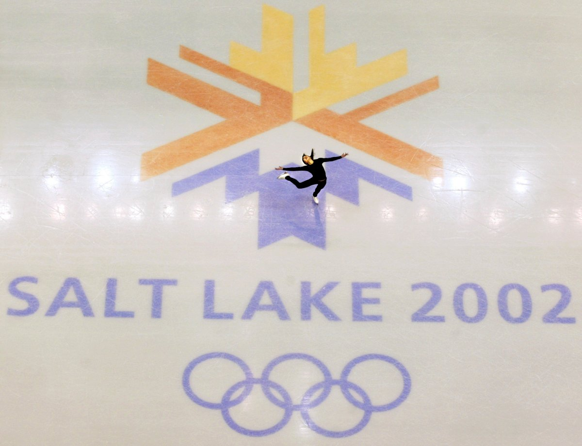 FILE - This Feb. 8, 2002, file photo, shows U.S. champion Michelle Kwan practicing for the women's short program for the Winter Olympic Games at the Salt lake Ice Center in Salt Lake City.
