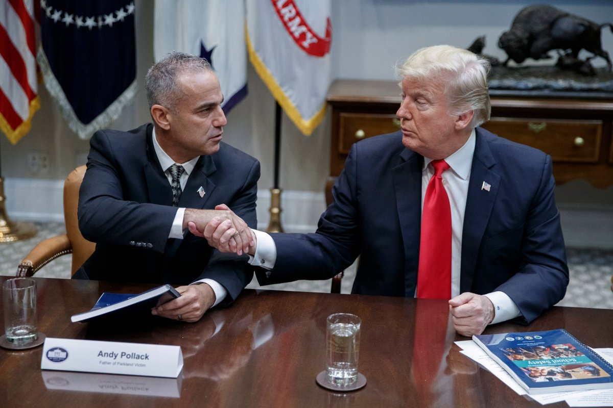 President Donald Trump shakes hands with Andy Pollack, the father of a Parkland school shooting victim, after a roundtable discussion on the Federal Commission on School Safety report in the White House in Washington, D.C., Dec. 18, 2018.
