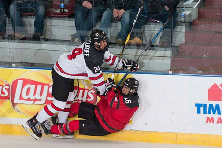 Alex Swetlikoff, left, seen here playing for Team Canada, joined the WHL's Kelowna Rockets on Tuesday afternoon.