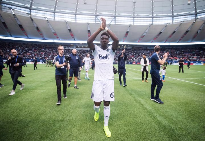 Vancouver Whitecaps midfielder Alphonso Davies salutes the crowd after playing his final match as a member of the MLS soccer team in Vancouver on October 28, 2018.